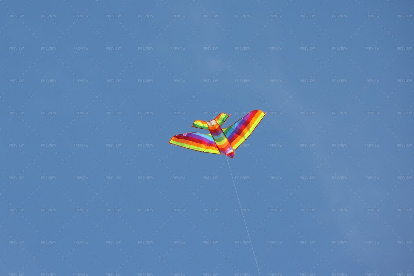 Multicolor Kite Hovers In Sky: Stock Photos