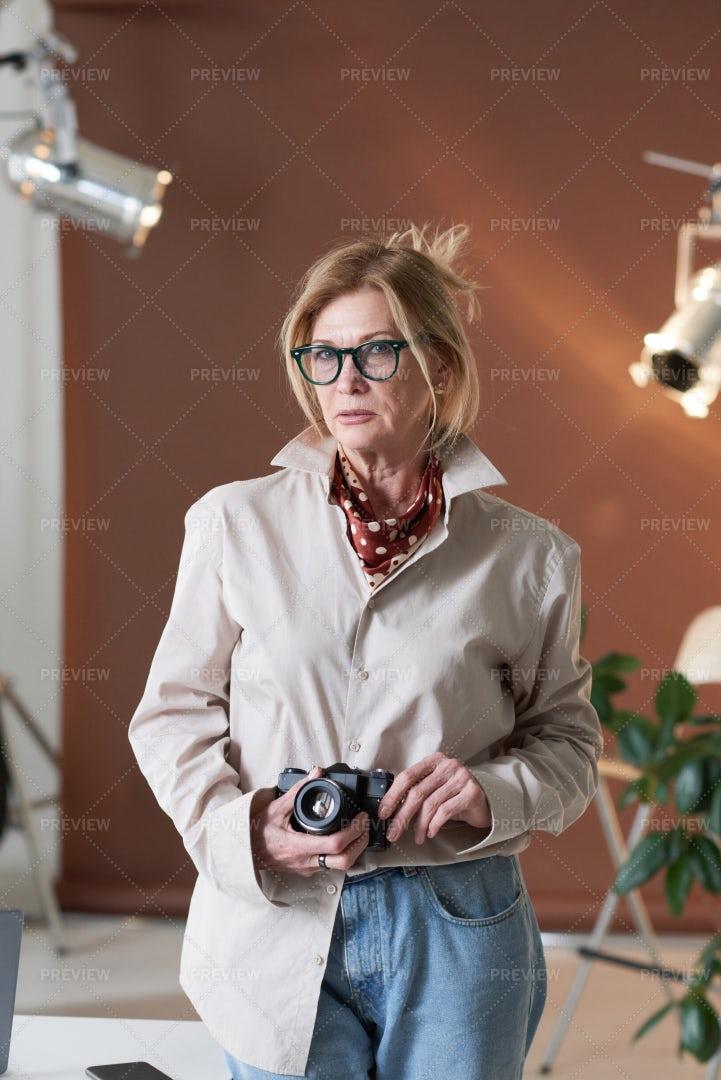 Photographer Standing At The Studio: Stock Photos