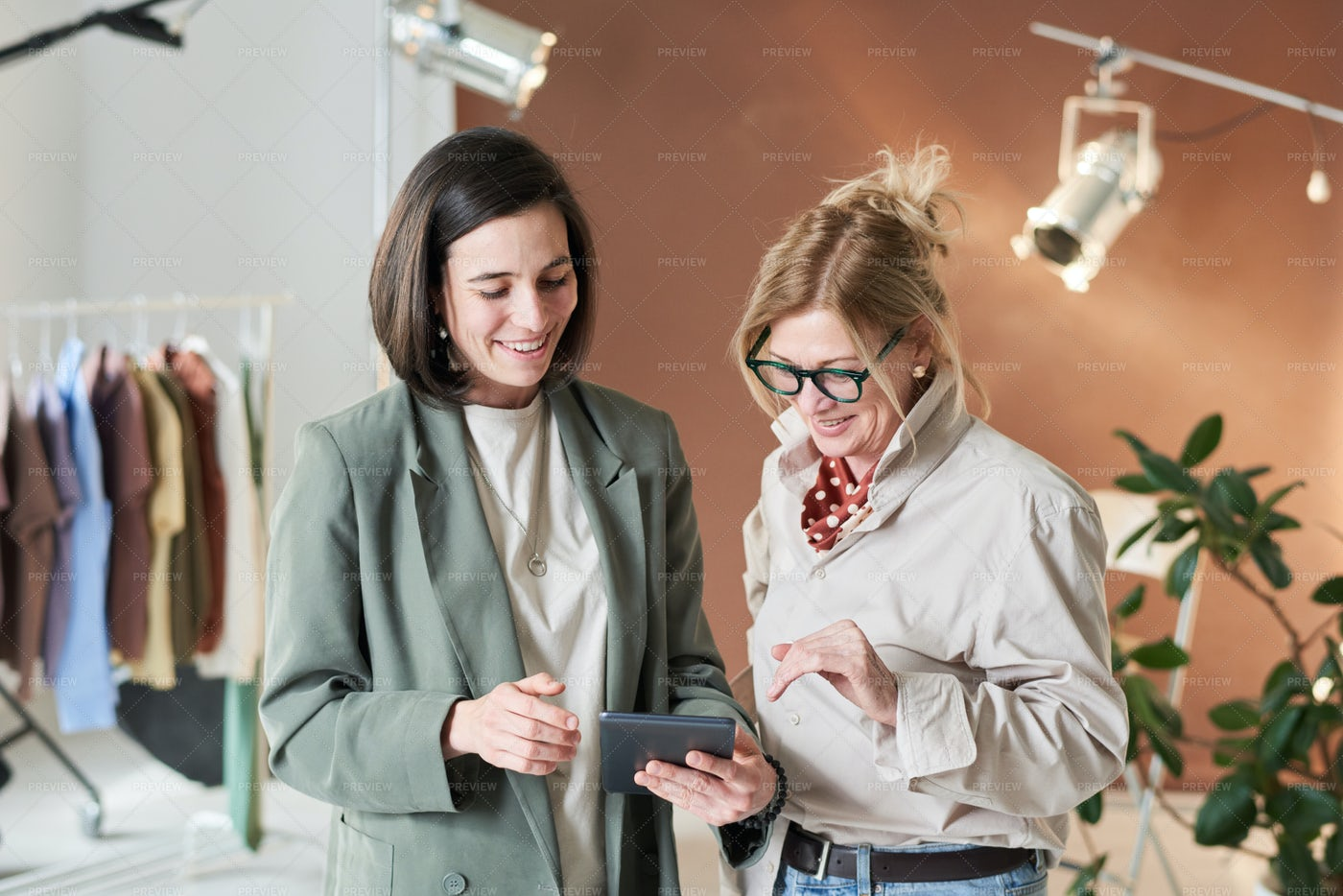 Two Designers Using Tablet: Stock Photos