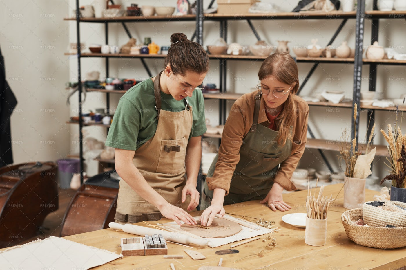 Two Artists In Pottery Workshop: Stock Photos