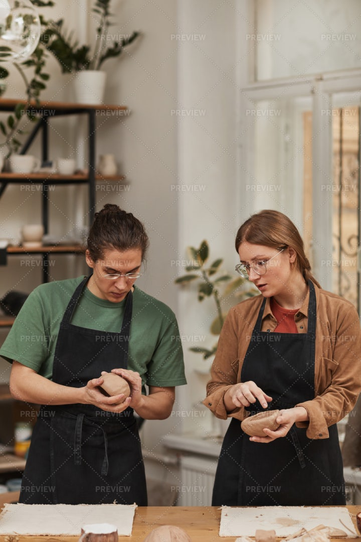 People In Pottery Workshop: Stock Photos
