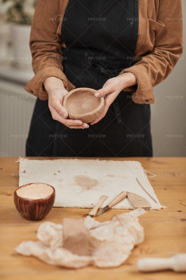Young Woman Making Ceramic Bowl: Stock Photos