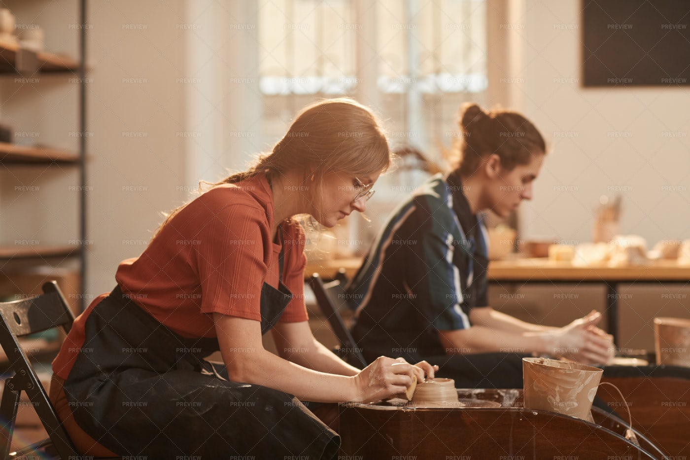 Man And Woman In Pottery Workshop: Stock Photos