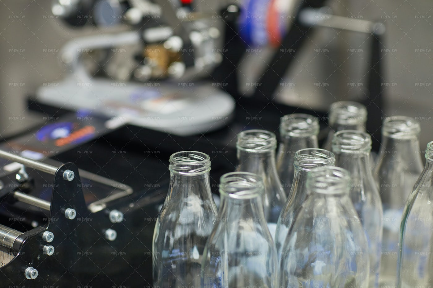 Glass Bottles At The Dairy Factory: Stock Photos