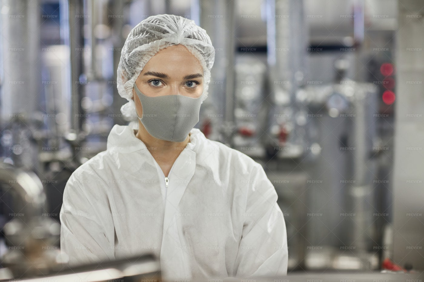 Factory Worker Wearing A Mask: Stock Photos