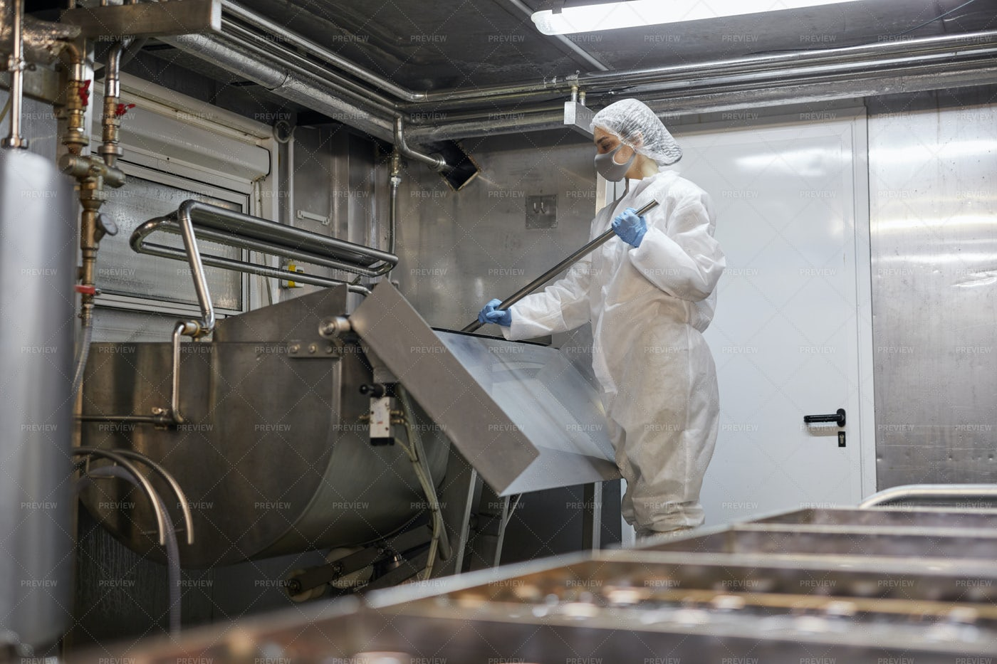 Woman Working At Dairy Factory: Stock Photos