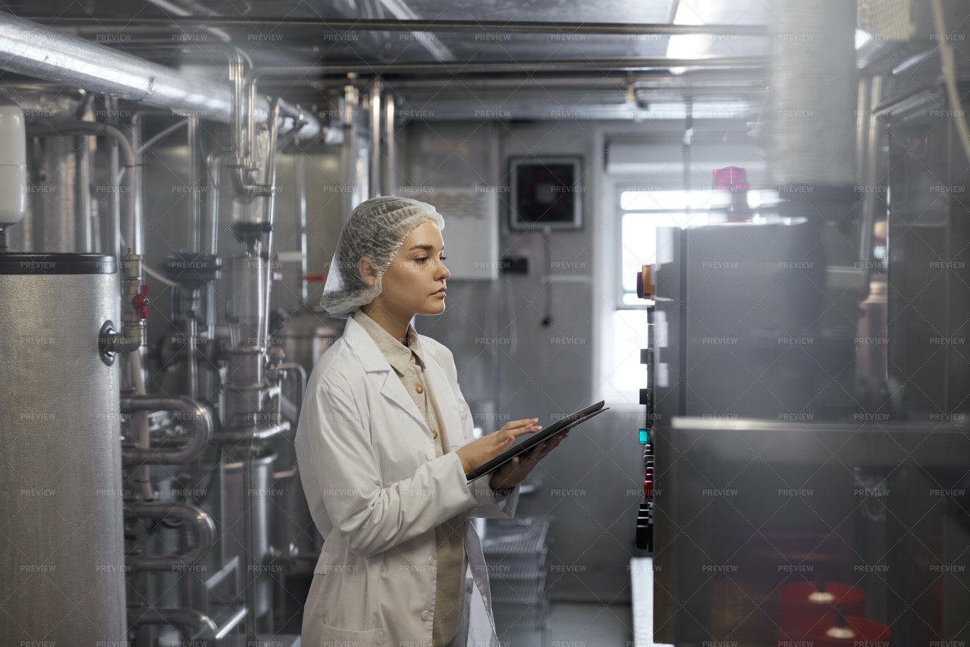 Woman Controlling Production: Stock Photos
