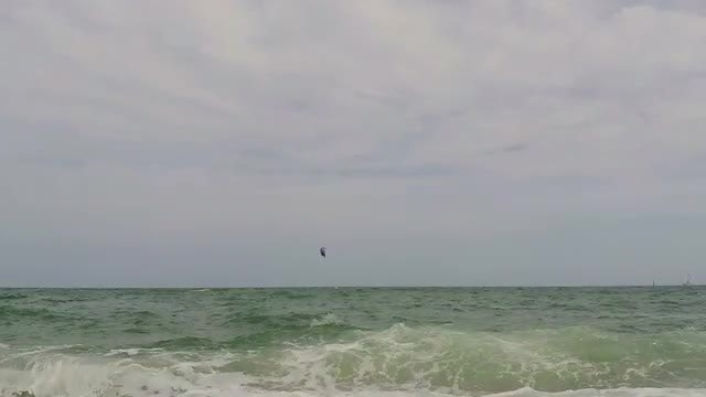 Parasailor Flying Over Turbulent Ocean: Stock Video