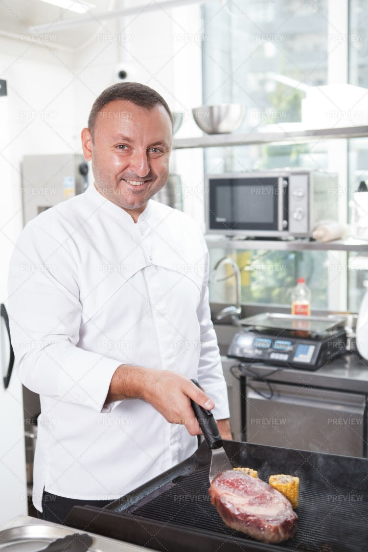 Smiling Chef Cooking: Stock Photos