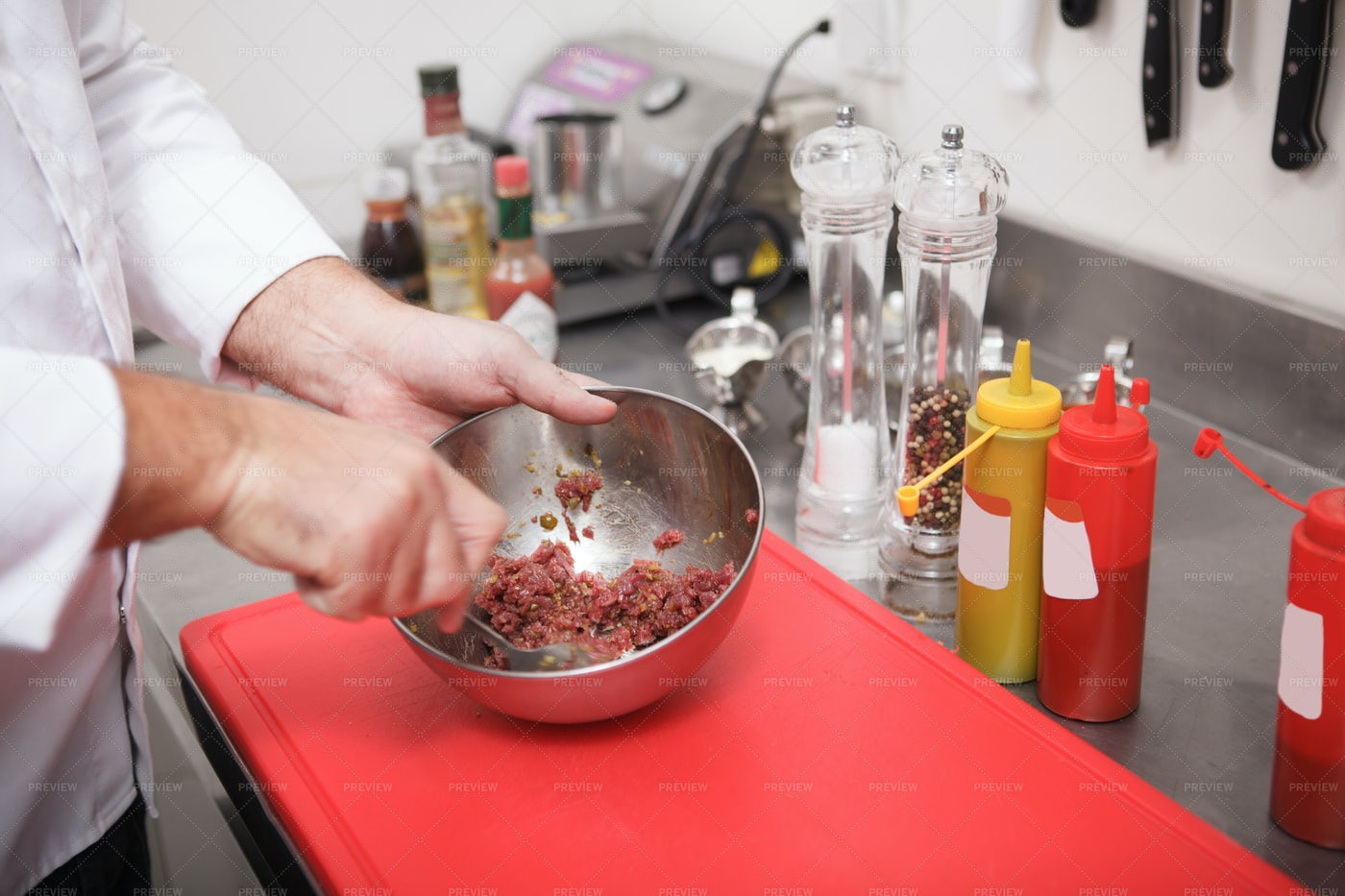 Chef Mixing Meat For Tartar: Stock Photos