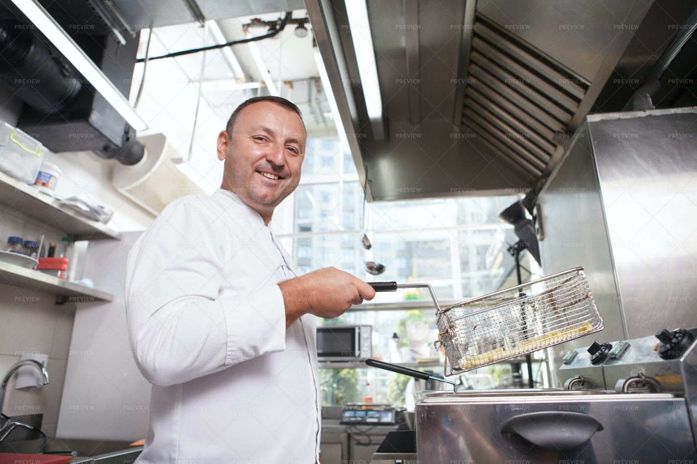 Chef Smiling While Cooking: Stock Photos