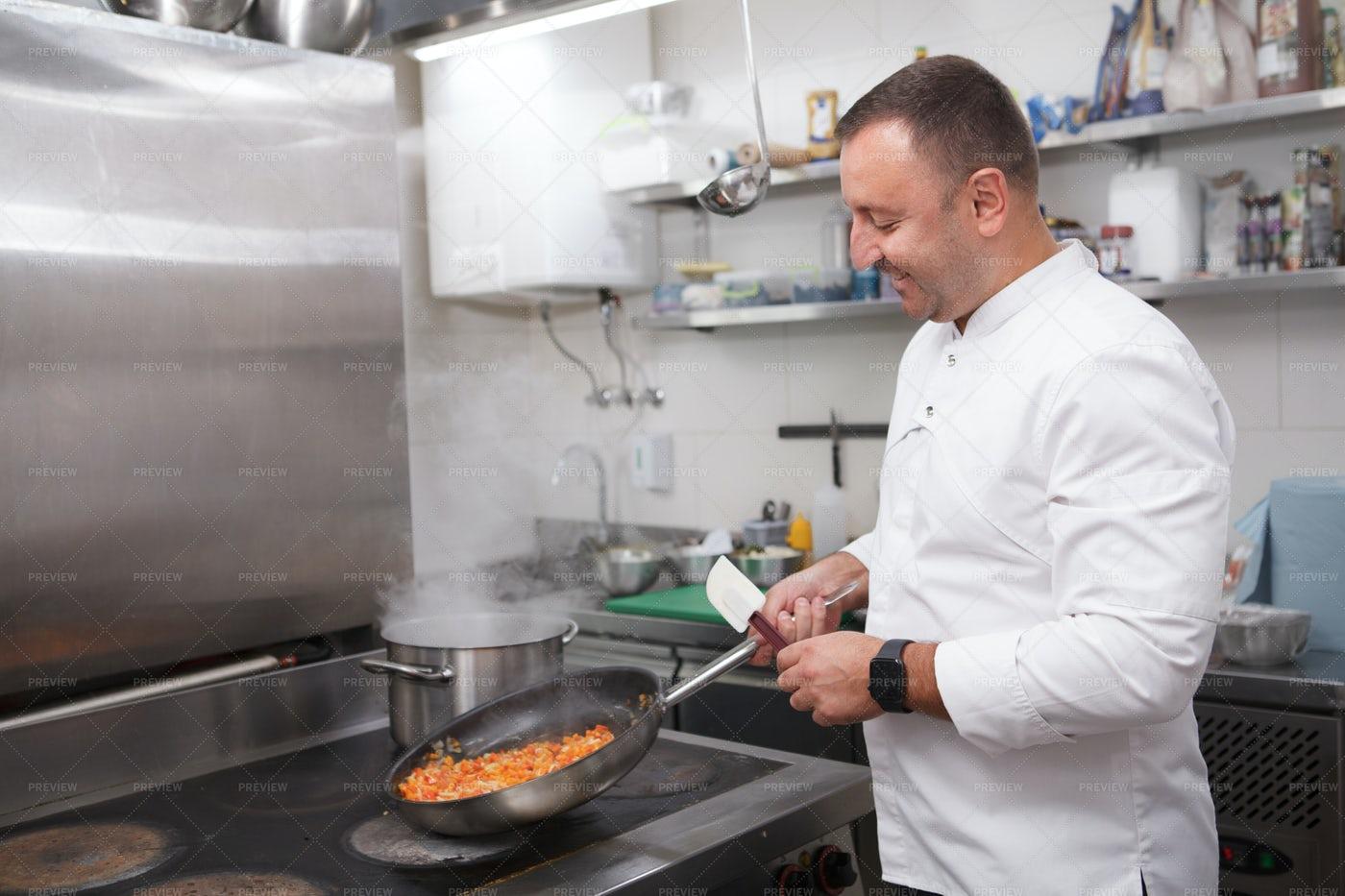 Chef Enjoying Cooking: Stock Photos