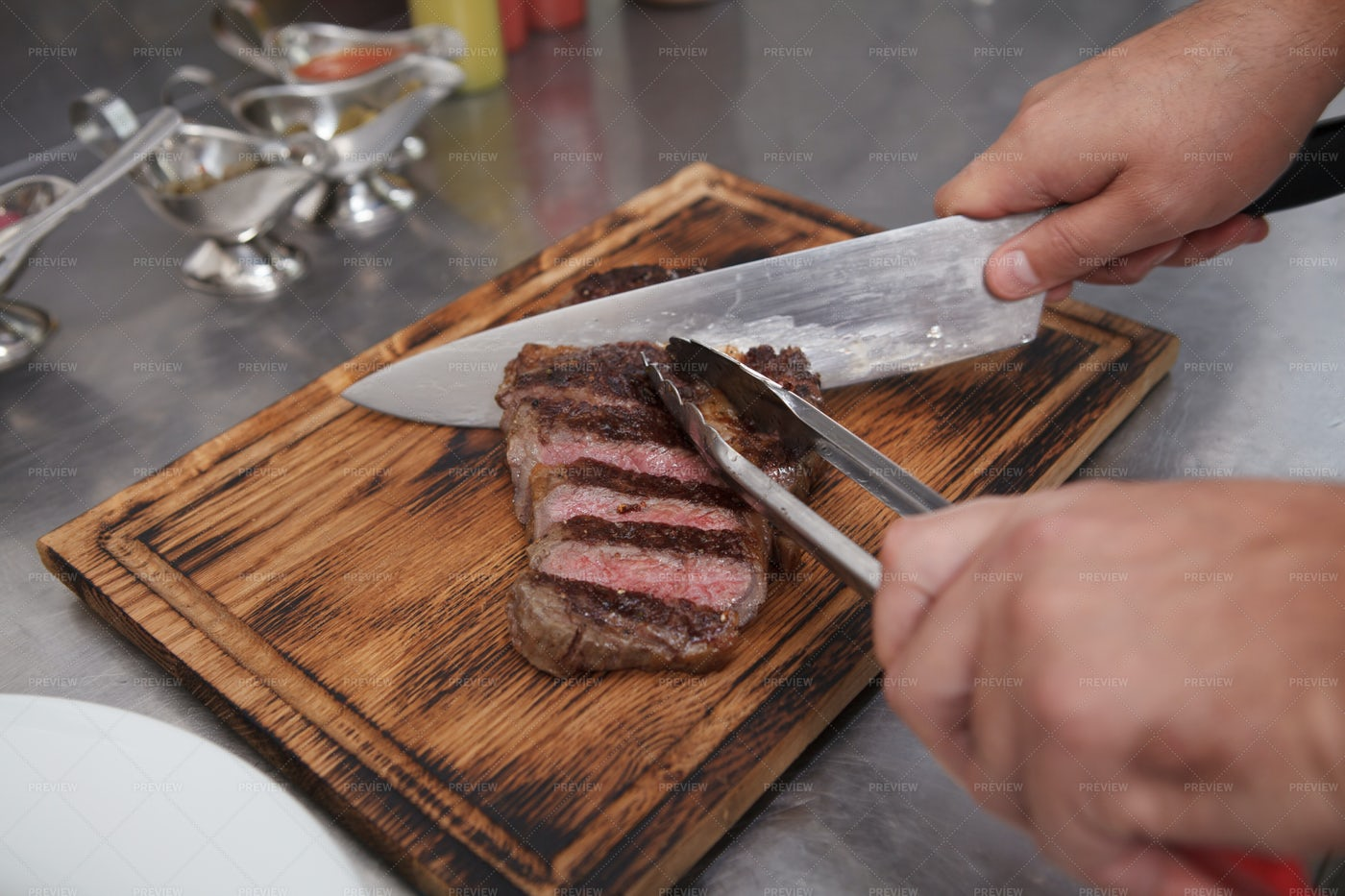Chef Slicing Beef: Stock Photos