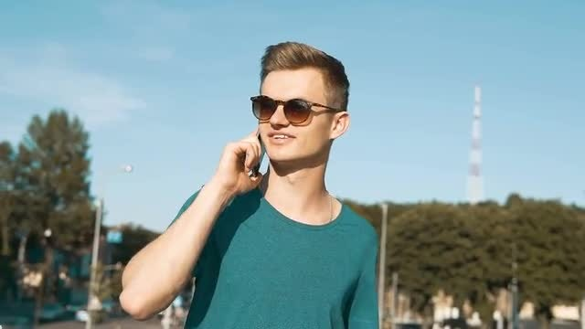 Young Man Talking On Phone : Stock Video