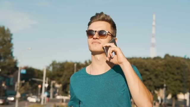 Handsome Guy Talking On Phone: Stock Video