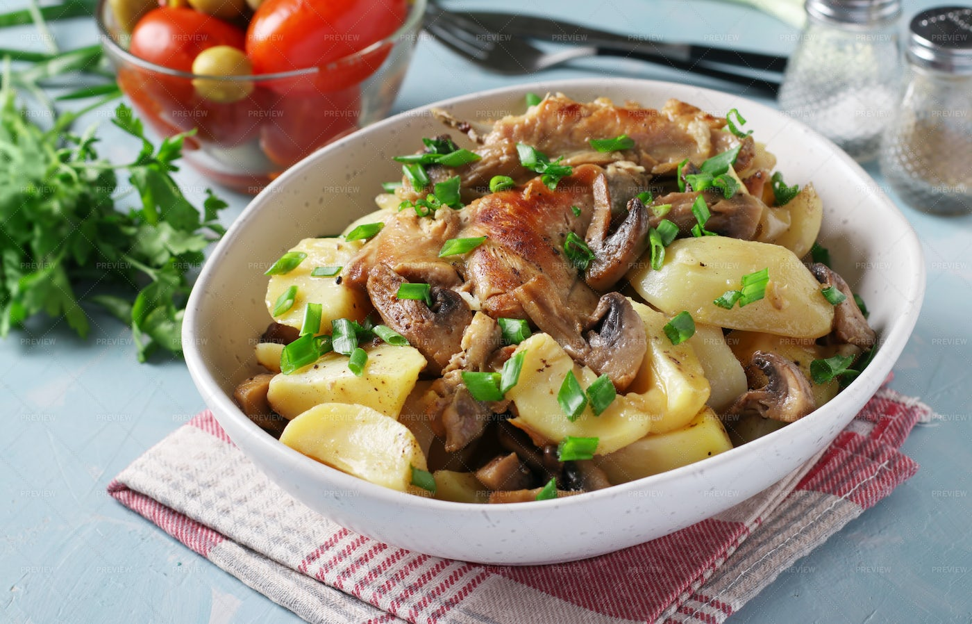 Rabbit Meat With Potatoes And Mushrooms: Stock Photos