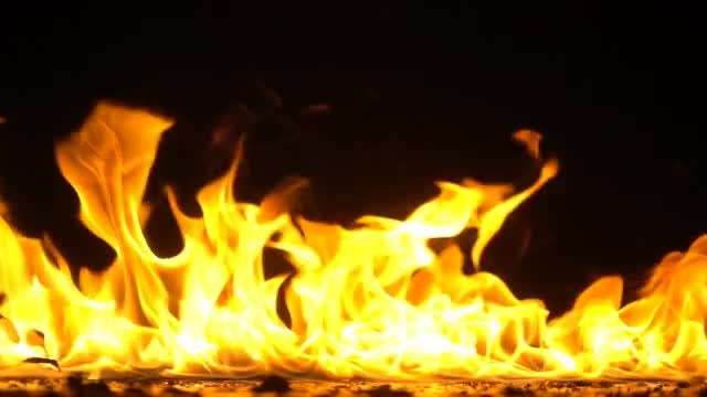 Golden Flames On Black Background: Stock Video