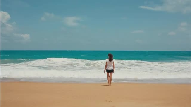 Girl Standing On Tropical Beach: Stock Video