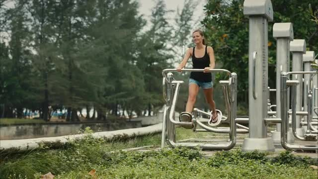 Young Woman Exercising Outdoors: Stock Video