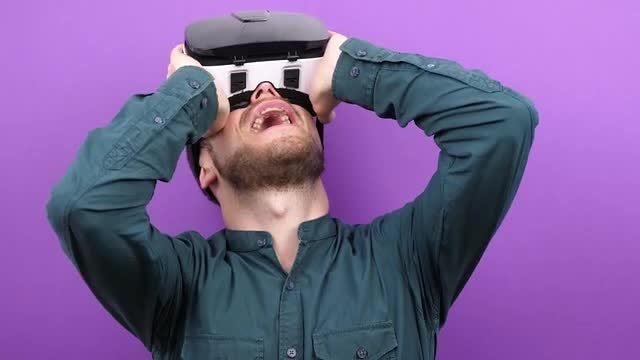 Excited Man Using VR Headset: Stock Video
