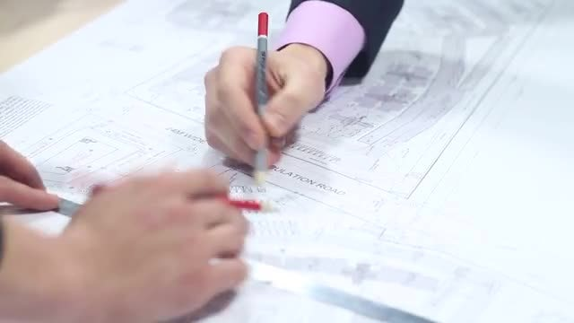 Male Architects Drawing A Plan: Stock Video