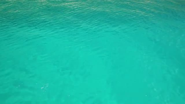 Turquoise Ocean With Small Ripples: Stock Video