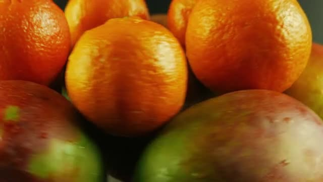 Rotating Mangoes And Tangerines : Stock Video