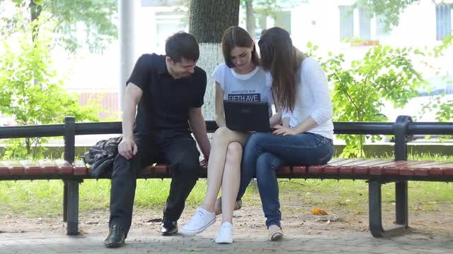 College Students  Hunch Over Laptop: Stock Video