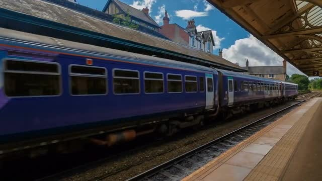 Traditional Train Leaving Station: Stock Video