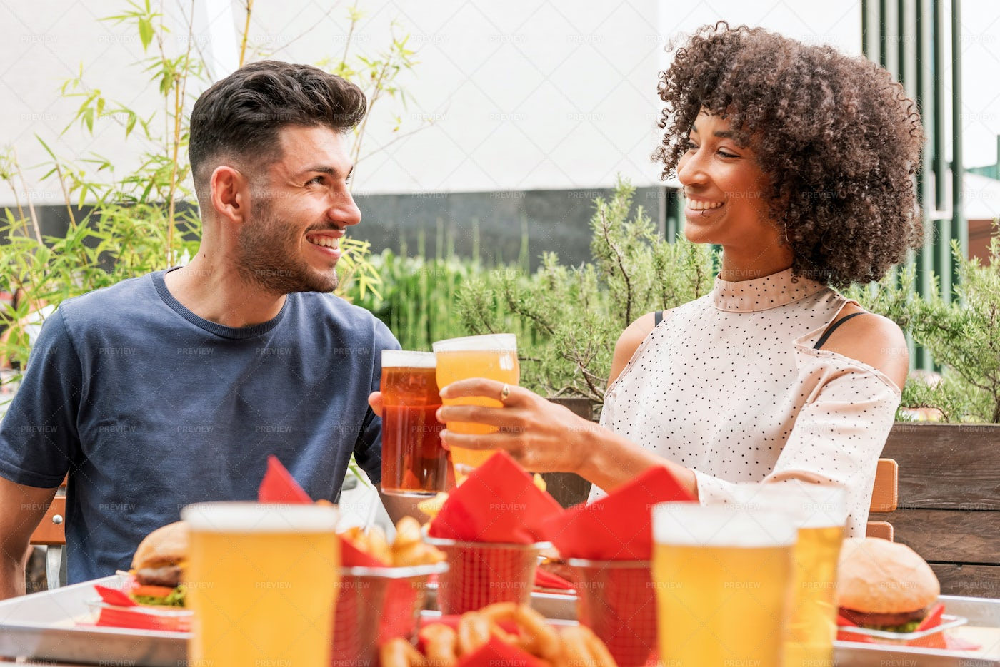 Couple Celebrating With Beer: Stock Photos