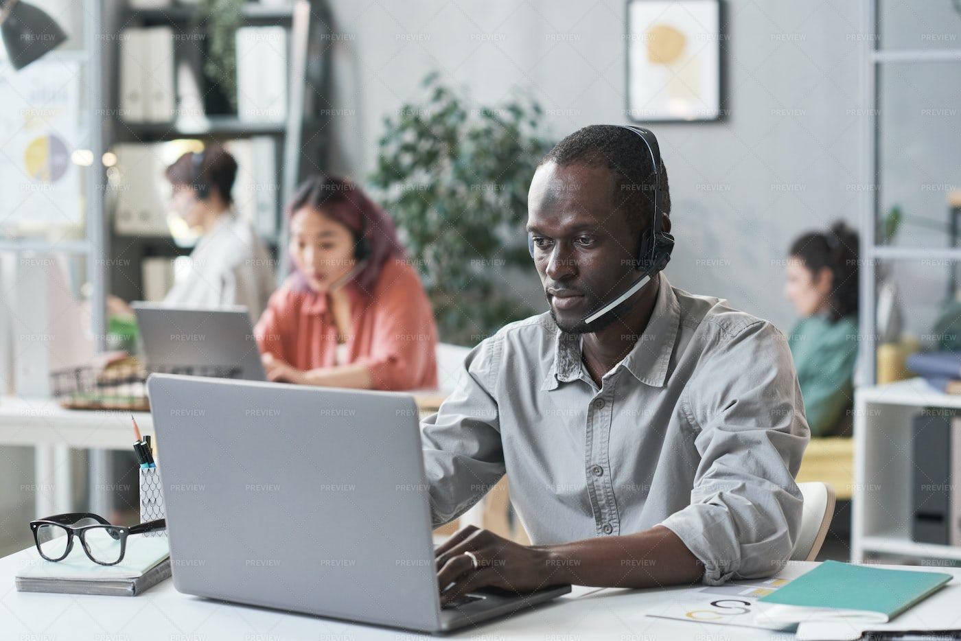 Young Man Working In Call Center: Stock Photos