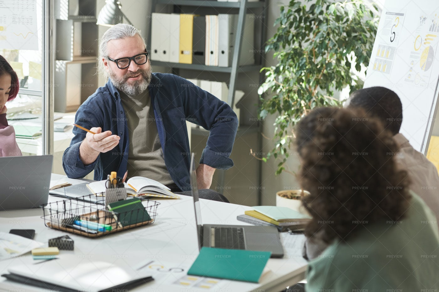 Businessman Talking To Coworkers: Stock Photos