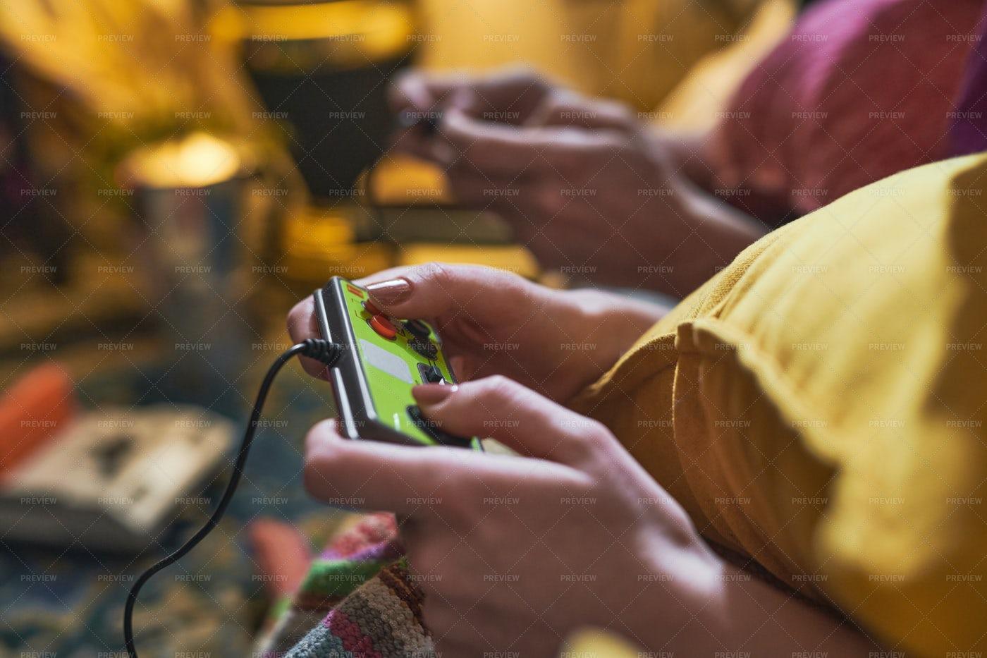 Woman Playing With A Joystick: Stock Photos