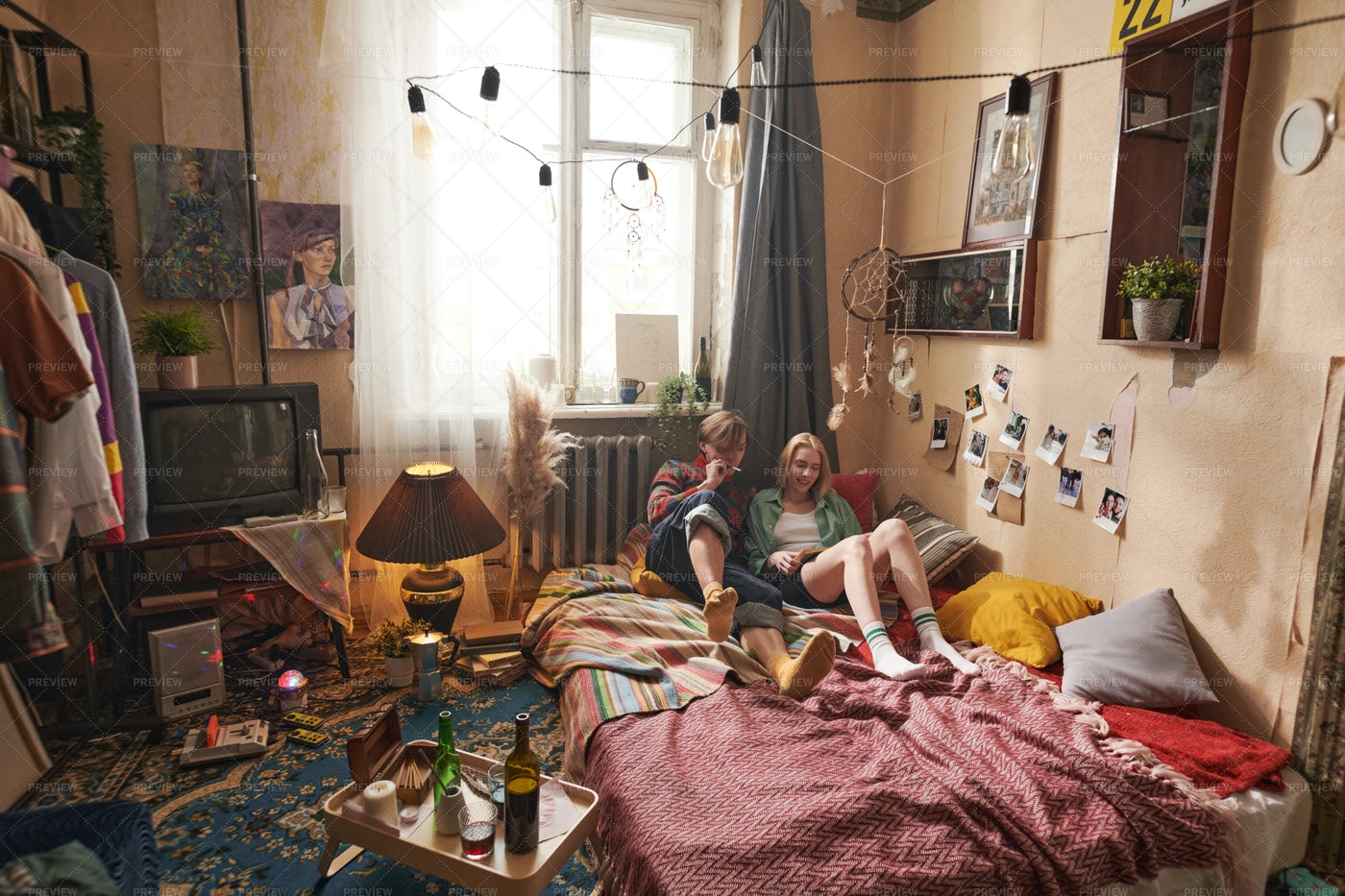 Couple Relaxing In The Room: Stock Photos
