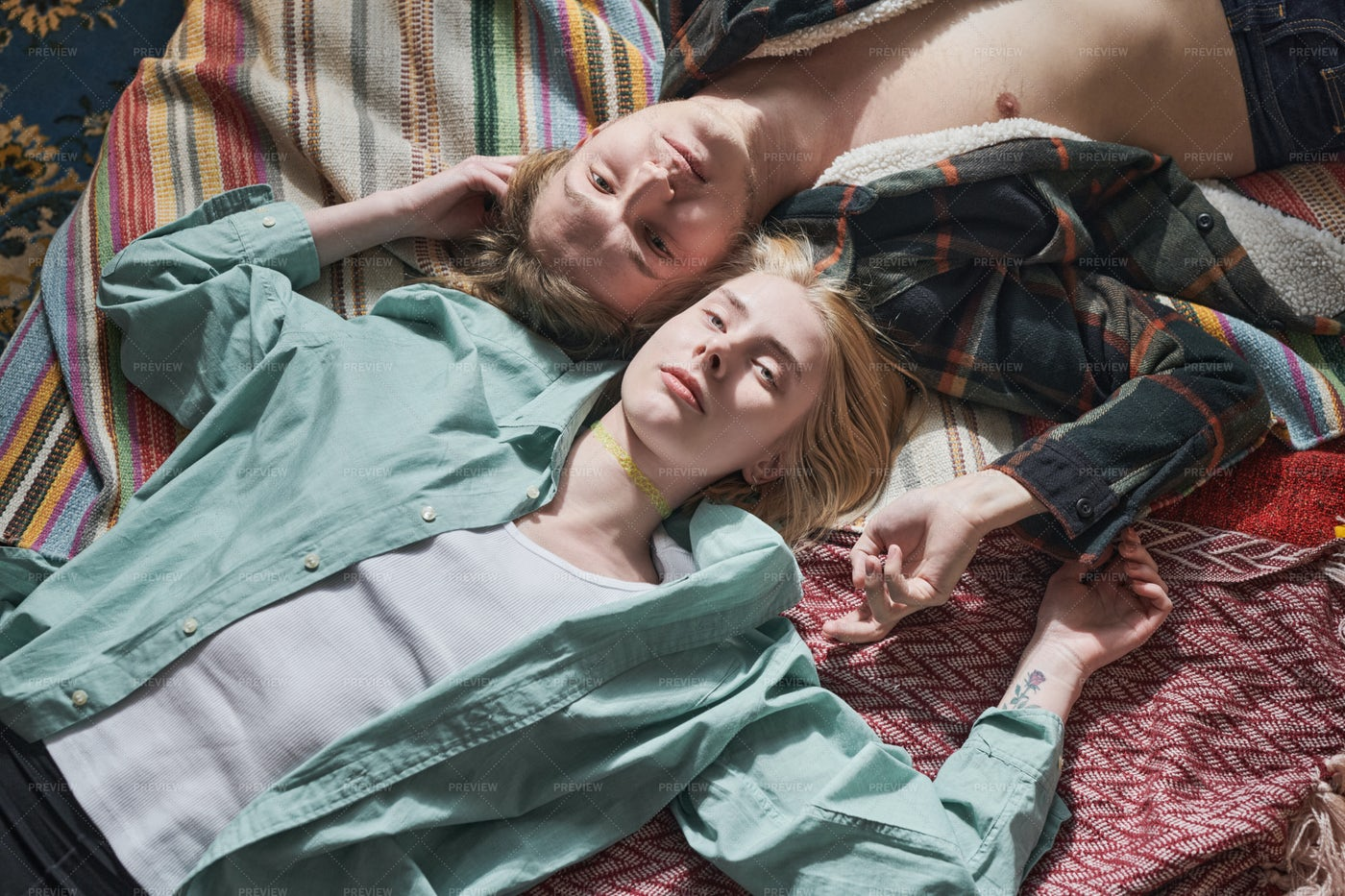 Young Couple Lying On The Bed: Stock Photos