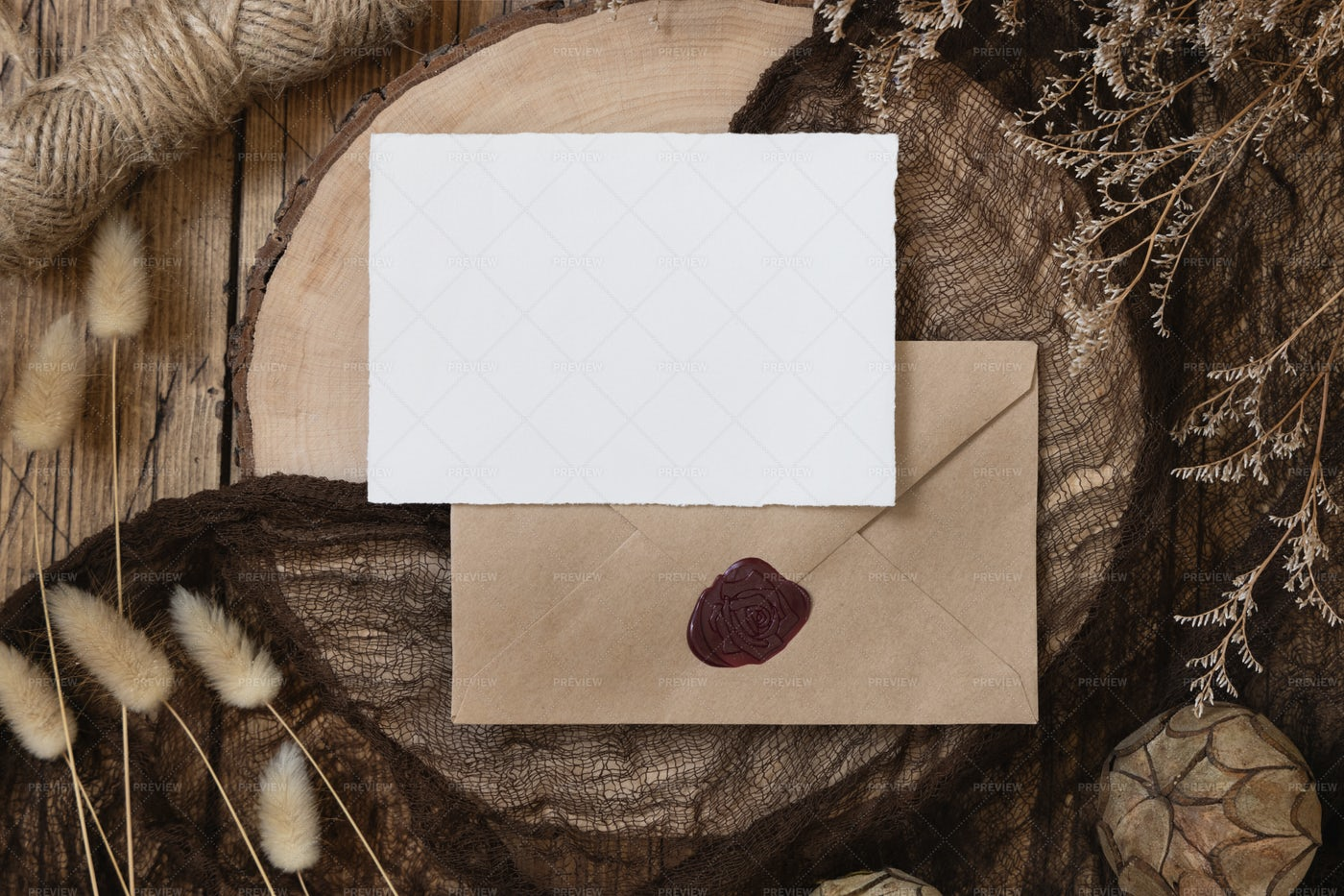 Card On Envelope And Wooden Table: Stock Photos