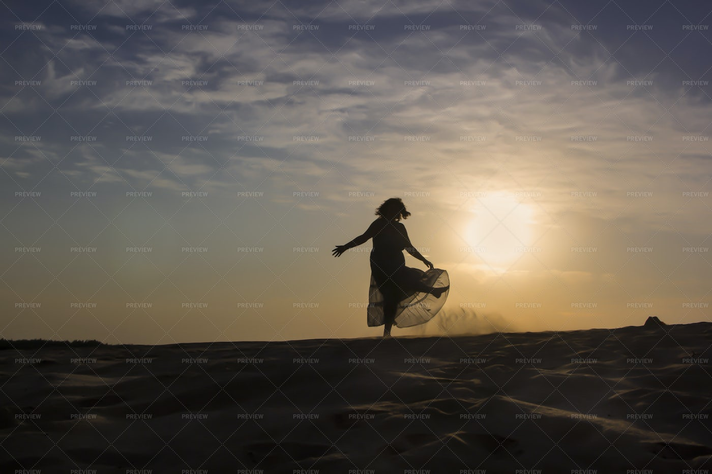 Silhouette Of Woman On Sand: Stock Photos