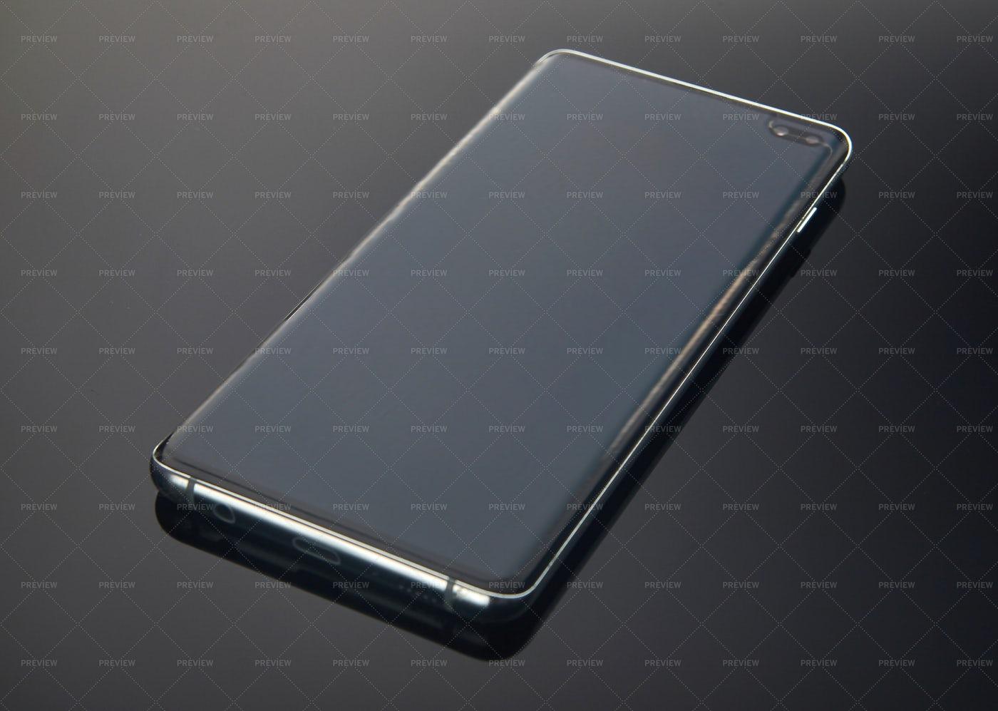Smartphone On Dark Gradient Background: Stock Photos