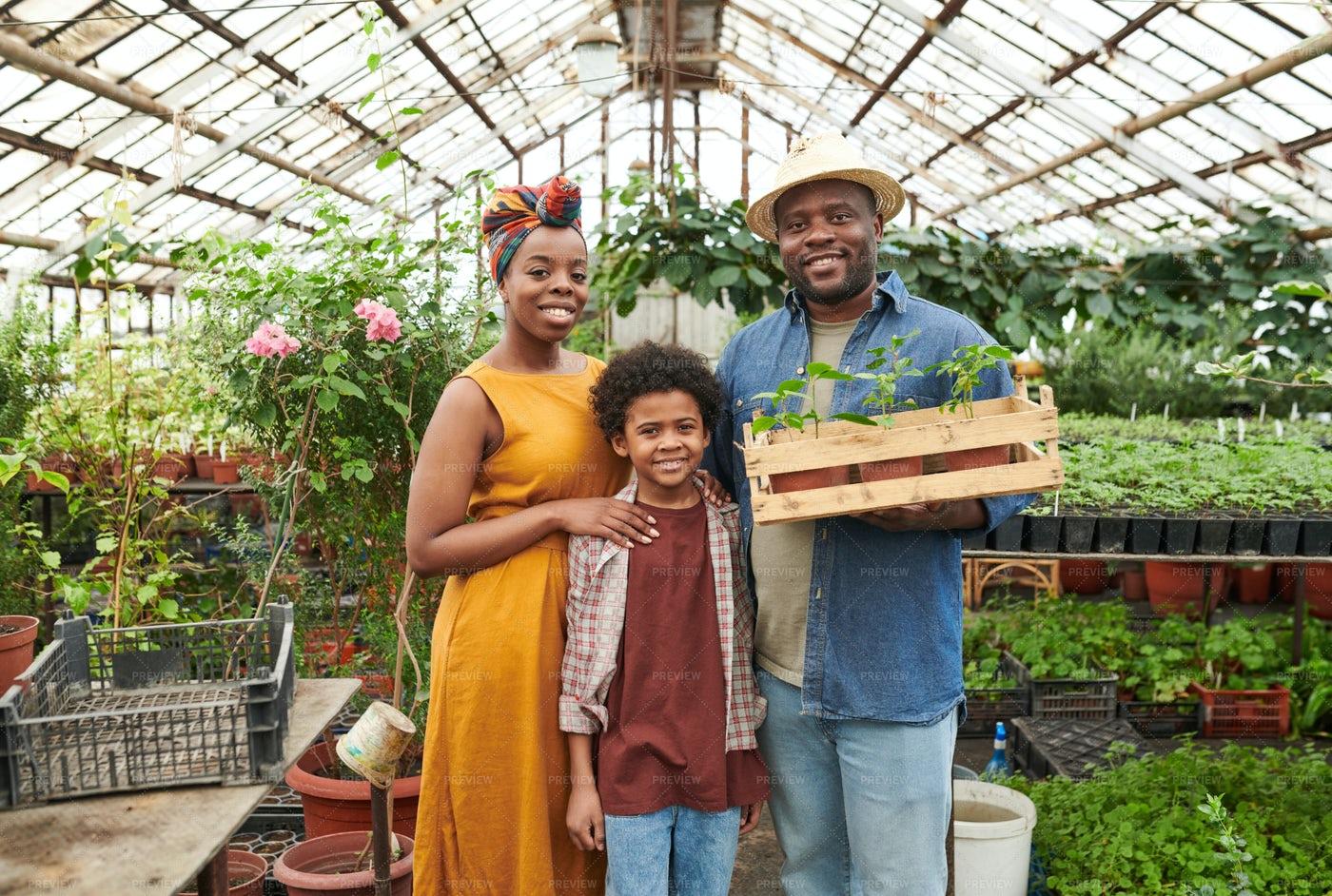 Family Standing In A Garden: Stock Photos