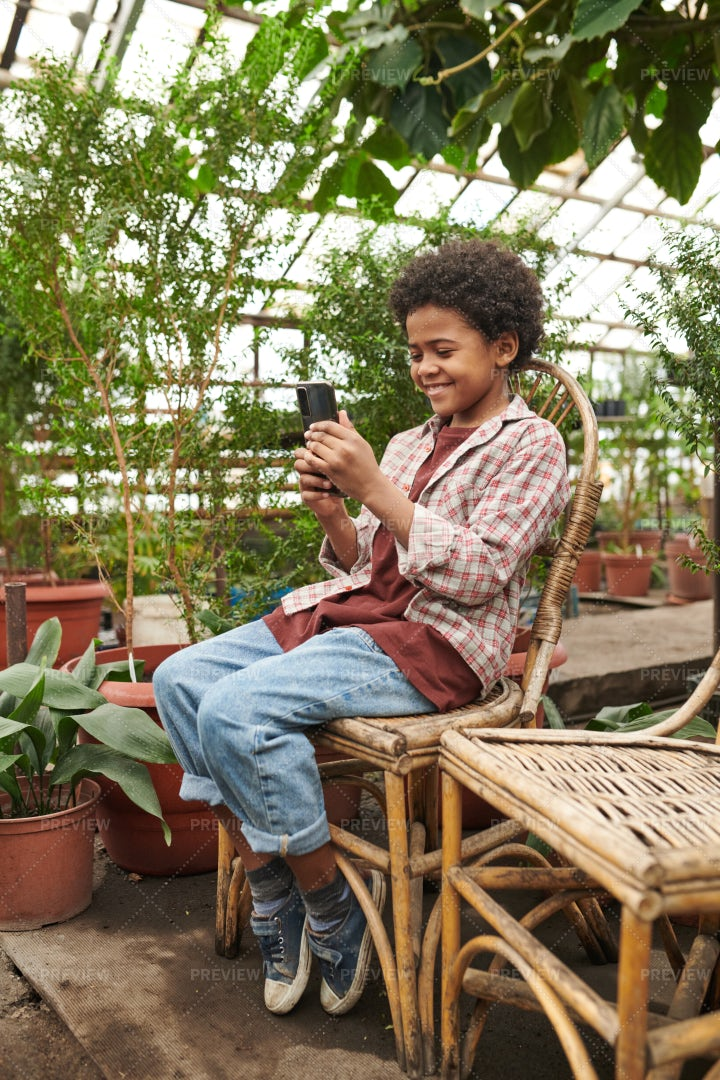 Kid Playing On Mobile Phone: Stock Photos