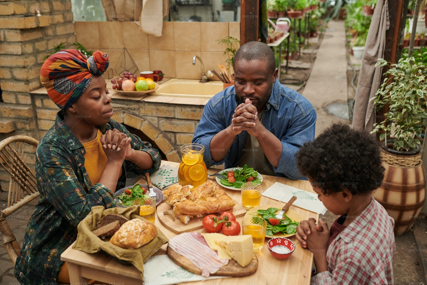 Family Praying At The Table: Stock Photos