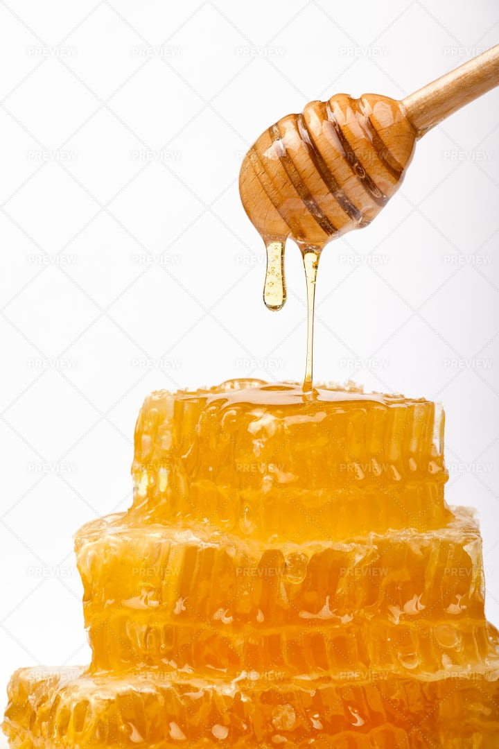 Comb Honey And Wooden Dipper: Stock Photos