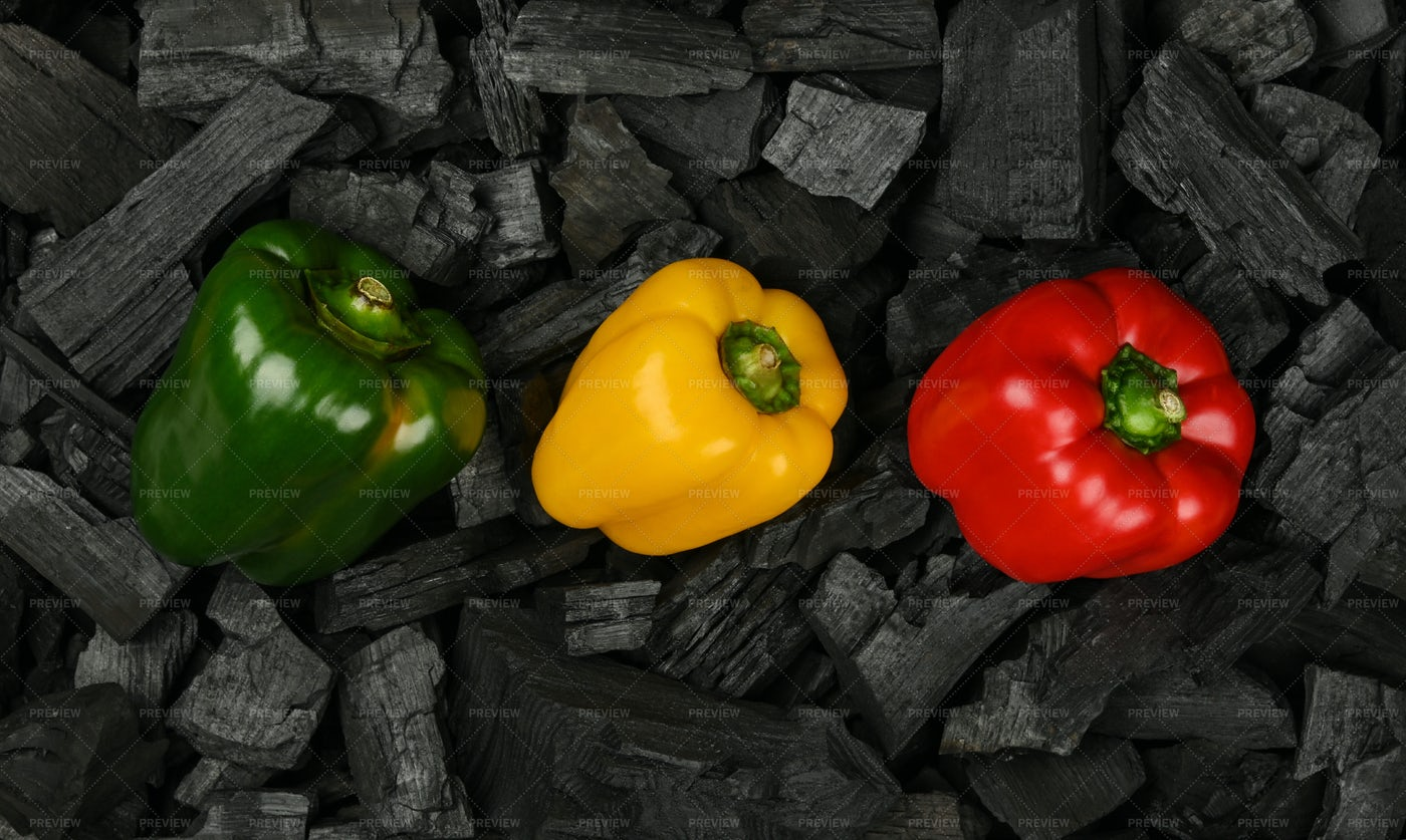 Peppers Over Charcoal Pieces: Stock Photos