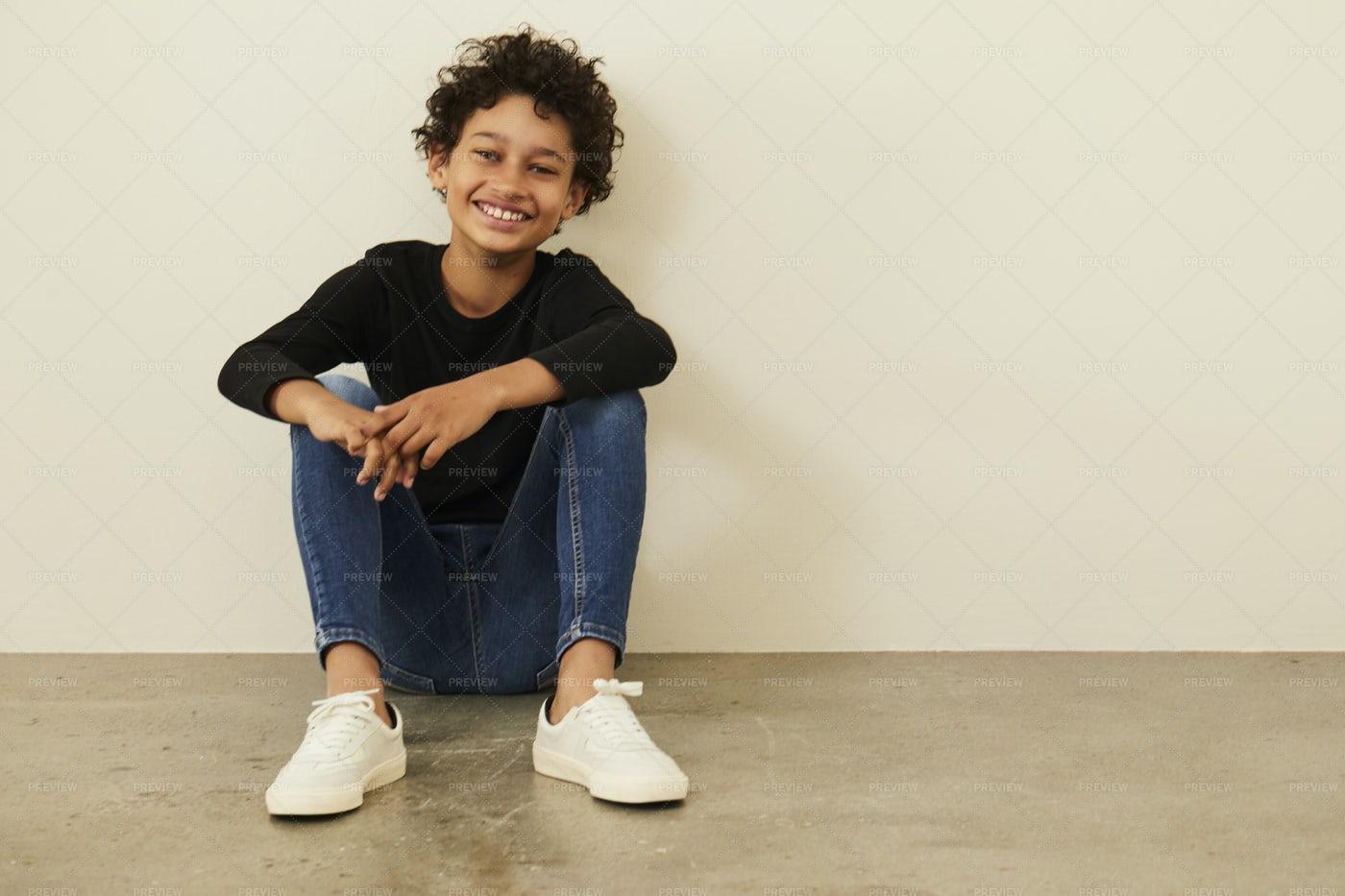 Kid Sitting On The Floor: Stock Photos
