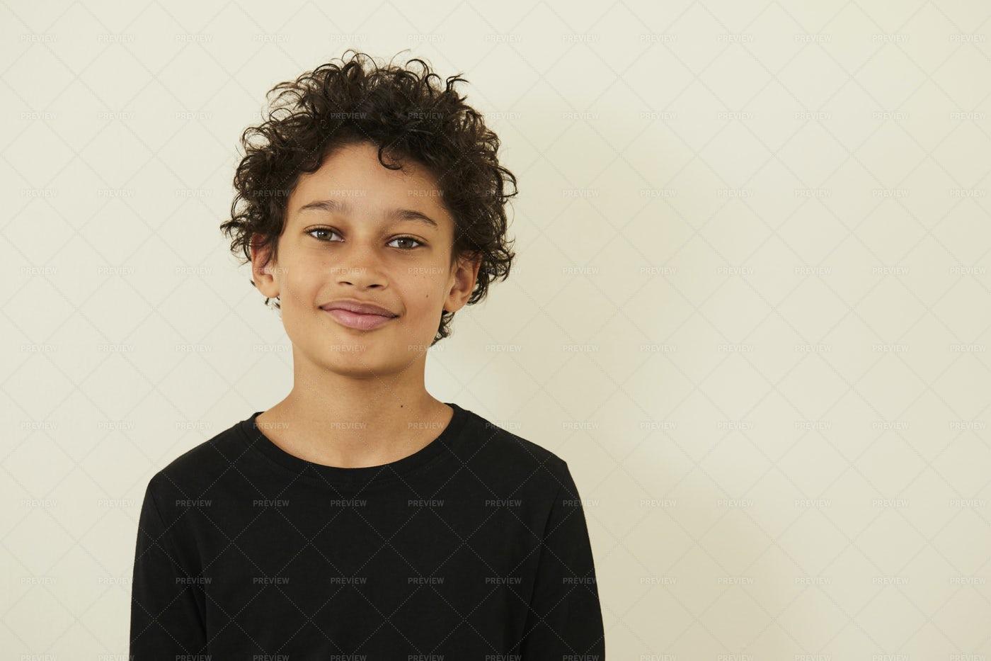 Boy On Beige Background: Stock Photos