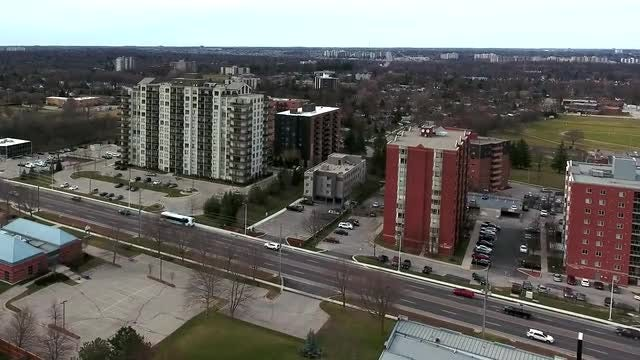 Traffic By Tall Apartment Buildings Aerial: Stock Video