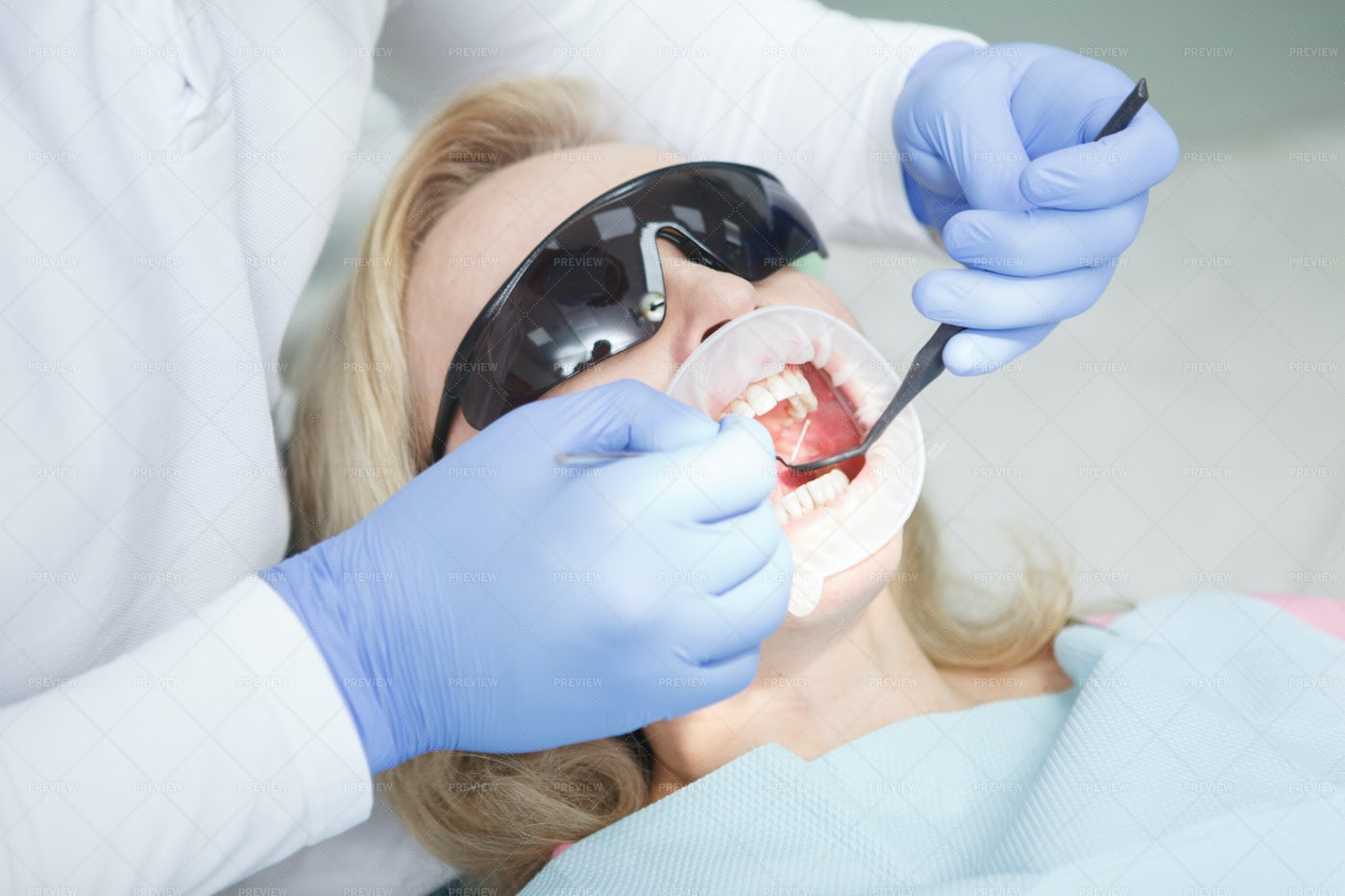 Woman Getting A Dental Treatment: Stock Photos