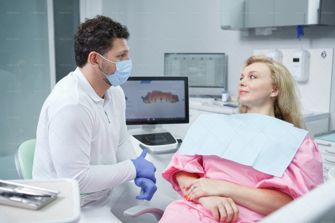 Dentist And Patient At Clinic: Stock Photos