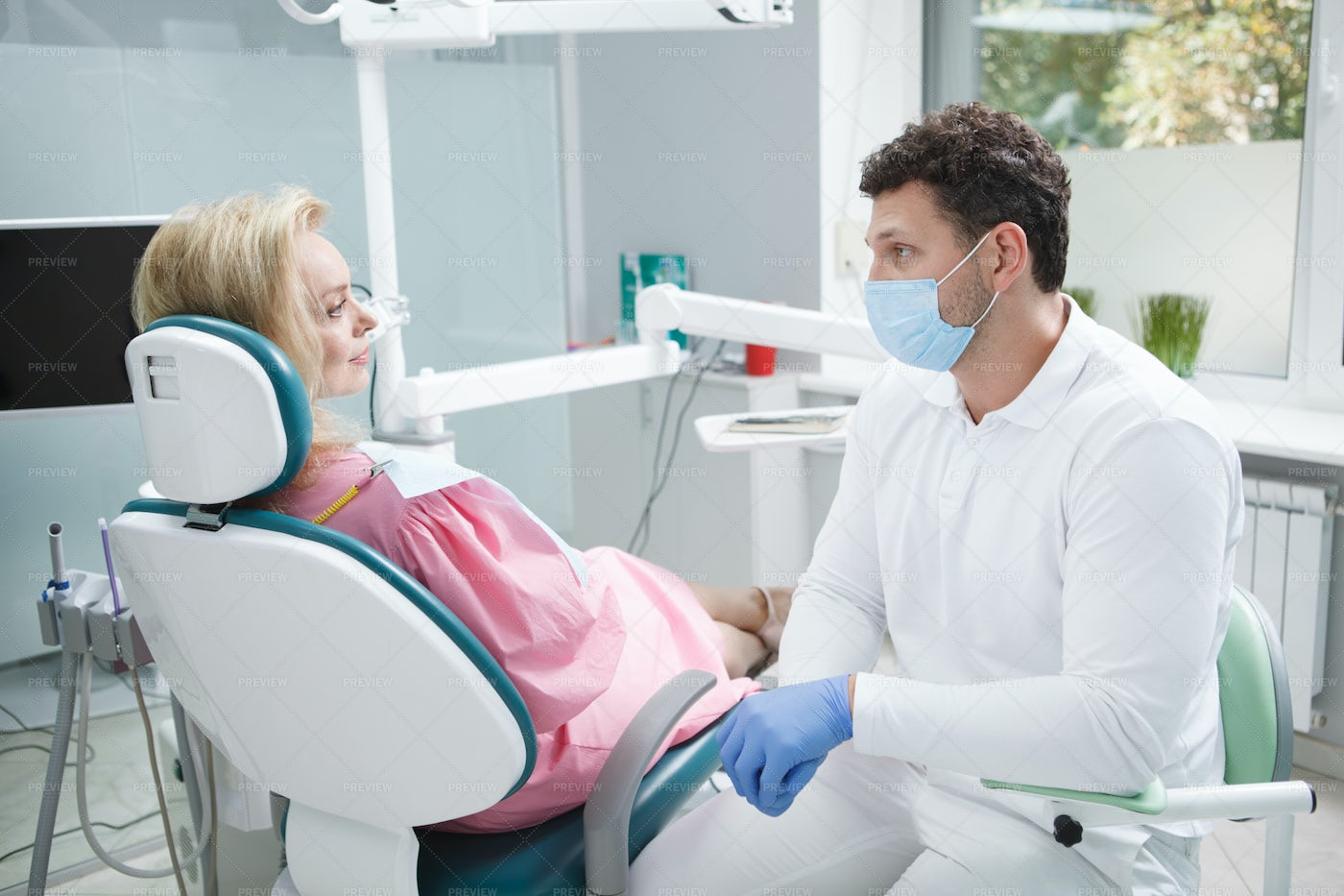 Woman Patient With A Dentist: Stock Photos