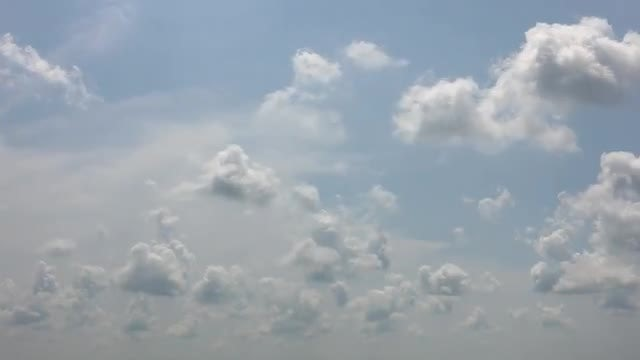 White Puffy Clouds Moving Forward: Stock Video